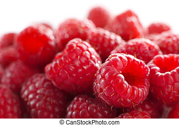 raspberries against white - Macro of a stack of raspberries...