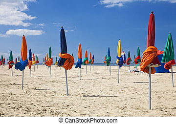 Colorful Parasols on Deauville Beach, Normandy, France,...