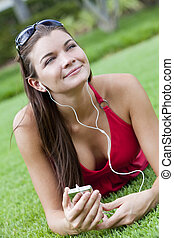 Beautiful Brunette Woman laying Down Listening to MP3 Player...