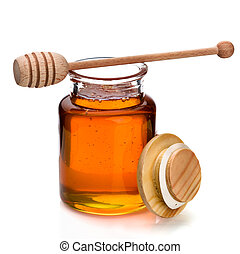 Honey jar and dripper - Honey in a glass jar with wooden...