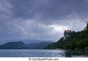 Lake Bled at Dusk with dark cloudy sky, Slovenia, Europe