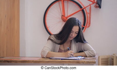 Young beautiful woman is working in studio office.