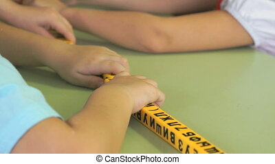 Hands of little boys studying numbers and letters - Hands of...