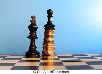 power of the money concept. Chess pawn standing on the money...