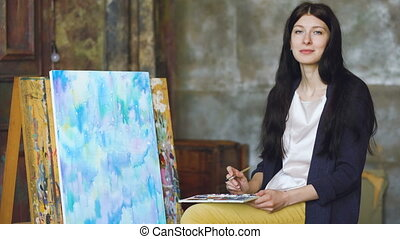 Young woman artist draw pictrure with watercolor paints and...