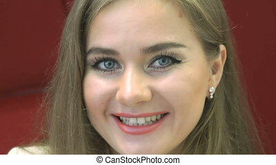 Positive young woman smiling at camera - Positive young...