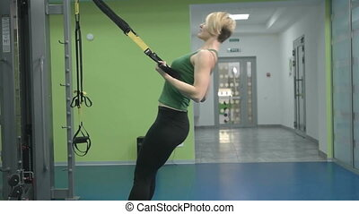 sporty young woman doing exercise at the gym