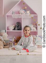 girl in pajamas in the children's room