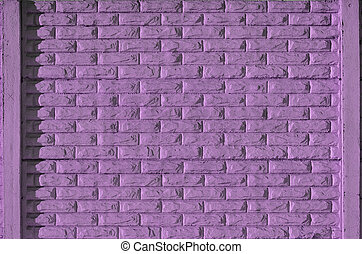 Stone fence texture - building feature. Texture of purple...
