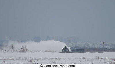 Snowplow clears the runway - Snow thrower clears the runway,...