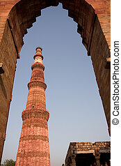 Qutab Minar through arch, Delhi, India Highest free standing...