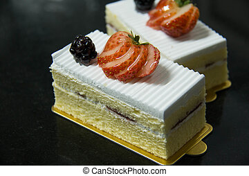 vanilla Cake with whipping cream and strawberry on top