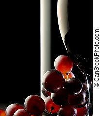 Red wine with grapes - Close-up of red grapes with glass and...
