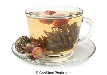 Glass cup with flowering tea