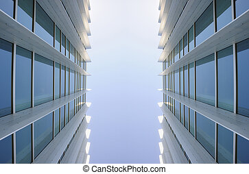 Exterior windows of two identical modern buildings -...