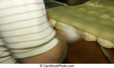 Rolling the dough into a rope hands.