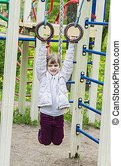 Happy little girl playng on outdoor playground - Happy...