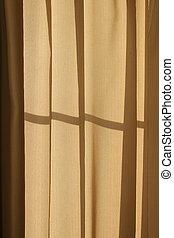Morning sun shines through the curtains.