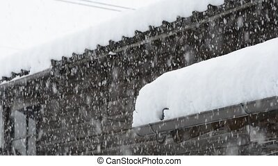Heavy snow - Wooden building piled heavy snow in winter