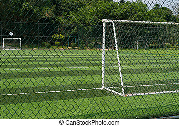 soccer field behind the fence