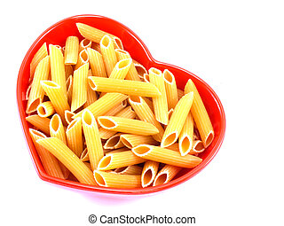 macaroni italian pasta close up in heart bowl isolated on white background