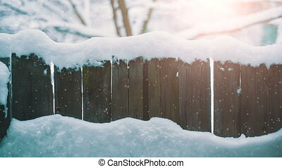 Rustic fence at winter - Rustic fence covered with snow at...