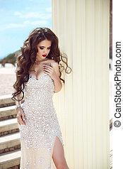 Hair. Bride. Beautiful brunette woman in fashion dress,...