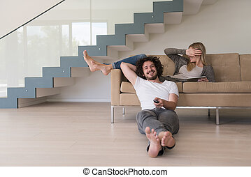 young couple relaxes in the living room