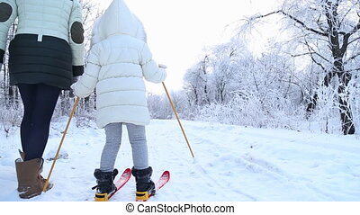 child skiing in the winter forest