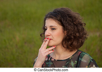 Casual young woman smoking a cigar