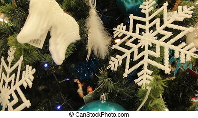 Christmas tree with white toys and decorations background....