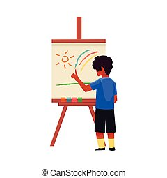 Little boy painting sun and rainbow on easel with fingers -...