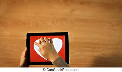 I love you calligraphy. Female writing thin inside white heart on tablet