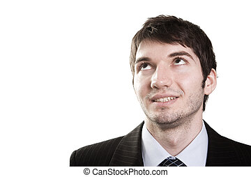 Business man looking up for inspiration - Isolated face of...