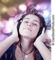 Active young teen woman listening dance music - Active young...