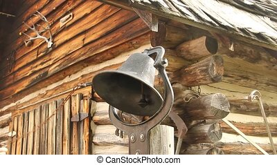 Vintage schoolhouse bell being rung by pulling the rope