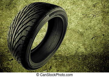 Tire - Rubber auto tire on abstract background