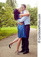 Embrace of happy cheerful joyful couple