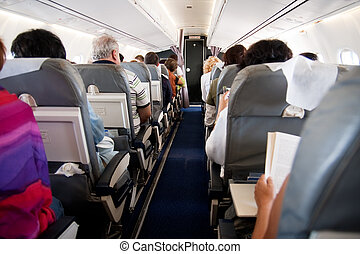 Interior of airplane with people inside - Interior of...