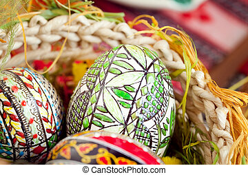 Easter painted eggs in traditional basket