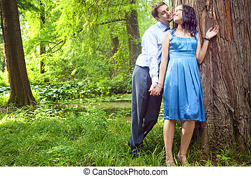 Beautiful couple having a romantic moment in the forest