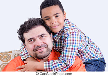 Cheerful child hugging father - Cheerful child in checkered...