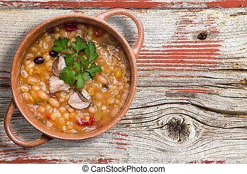 Bean and barley soup garnished with mushrooms - Bean and...
