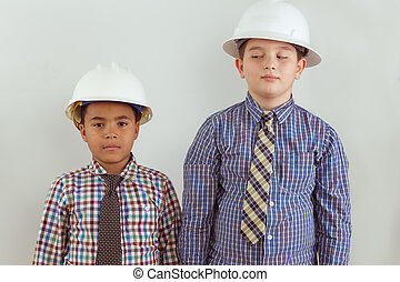 Two young aspiring tween engineers - Two multiracial young...