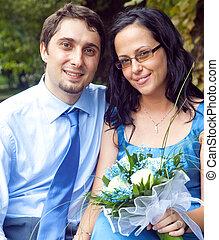 Portrait of happy cute couple outdoors