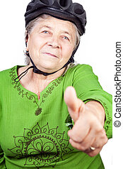 Confident old senior cyclist woman showing ok sign