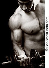 Gym and fitness concept - bodybuilder and dumbbell over...