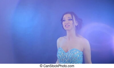 Singing woman on blue background - Attractive singing woman...