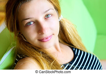 Cute friendly woman indoor on the couch - Cute friendly...