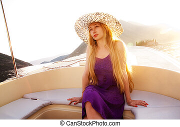 Beautiful blond woman on luxury boat - Beautiful elegant...